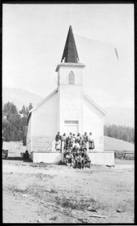 Group portrait in front of church