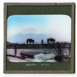 Two horses and figures on bridge in front of Mount Fujiyama