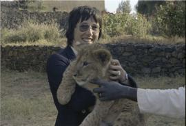 Lorna R. Marsden with lion cub (?)