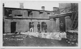 Military officers standing in front of crates