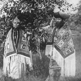 Reverend Thomas Crosby and unidentified woman in blankets and headdresses