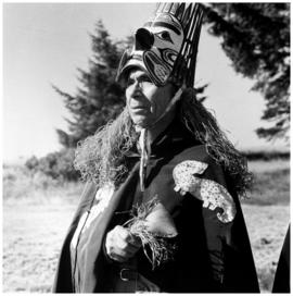 Mr. Wilson dressed in the traditional robes and mask of the [Nuu-chah-nulth]