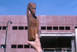 Eagle carving held aloft