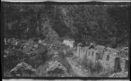 Ruins of stone buildings on a mountainside