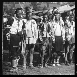 Group portrait of men in native clothing, view three