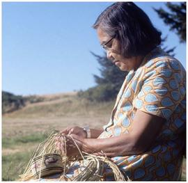Woman weaving basket