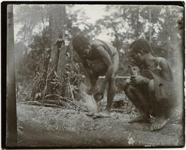[Local man making fire New Guinea]