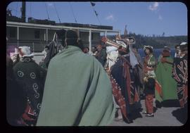 Group in ceremonial dress on dock, Alert Bay