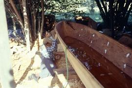 Unfinished canoe with Doug Cranmer and Godfrey Hunt