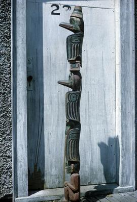 Side view of totem in front of door