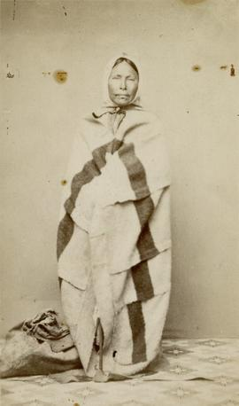 [Fort Rupert woman wrapped in blanket, B. C.]