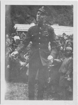 Soldier standing in front of a crowd