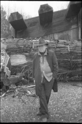 Bill Reid in front of canoe log