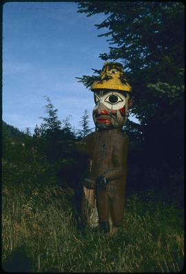 Pointing figure #14 (original), Saxman Park, Ketchikan, Alaska