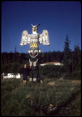 Woman next to thunderbird totem pole