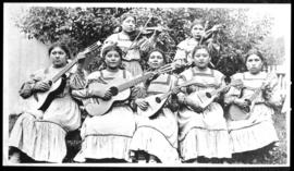 Group portrait of seven women playing musical instruments