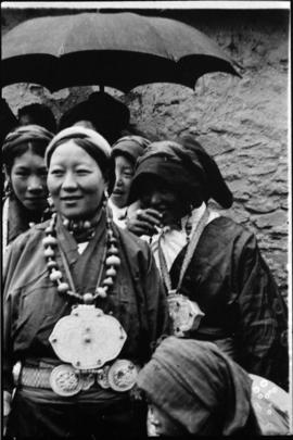 Women wearing pendants and belt