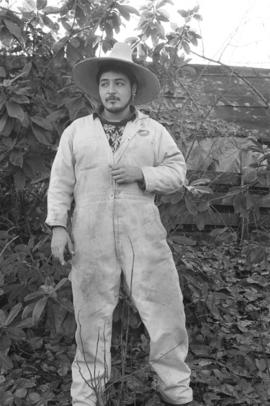 [Ron Telek wearing coveralls and hat]