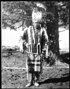 Portrait of young adult male in native dress