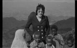Lorna R. Marsden with a group of children