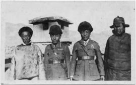 Group of four men posed for photograph
