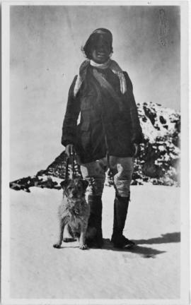 Man in snow with dog