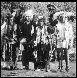 Portrait of four men in native dress