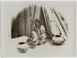 Zuni Dick's wife making pottery