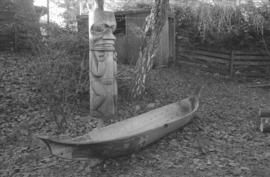 [Totem pole and canoe]