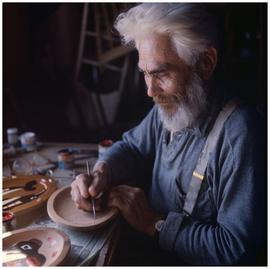 People (Haida) [man painting]