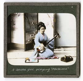 A Geisha girl playing shamisen