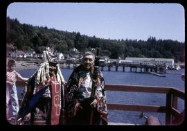 Two men in regalia on dock, Alert Bay