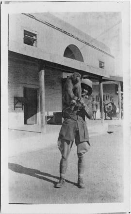Soldier holding a monkey