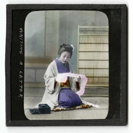 A woman kneeling on a cushion