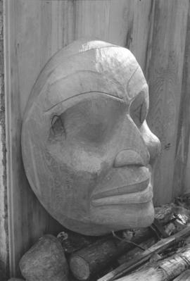 [Close-up of side profile of face carving]