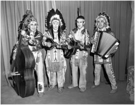 Dan George & band in traditional clothing