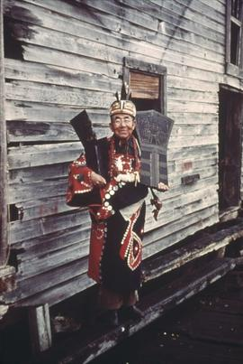 Man in regalia with coppers