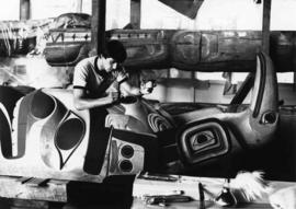Jim M. Hart working on a totem pole
