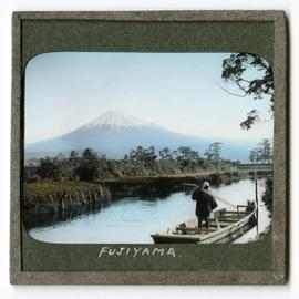 Boat on river in front of Mount Fujiyama