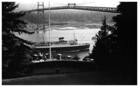 Ship sailing under Lions Gate Bridge