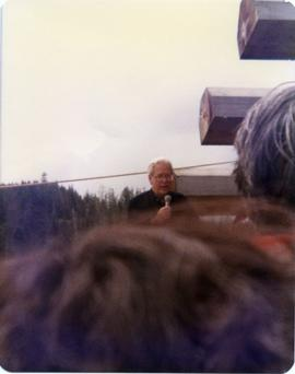 Bill Reid speaking at pole raising in Skidegate