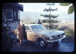 Audrey Hawthorn standing by a Mustang