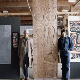 [Bill Reid next to artwork]