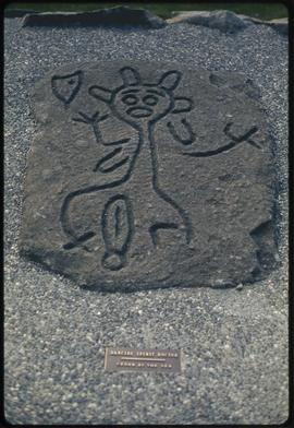 Dancing spirit doctor, Cedar By The Sea, petroglyph reproduction, Centennial Museum, Nanaimo, B.C.