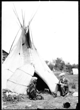 Portrait of two men in front of tipi, view four