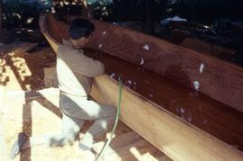 Working on a canoe
