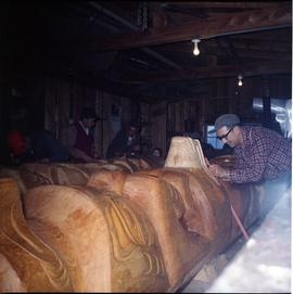 Carving totem poles in shed, Alert Bay (?)
