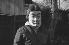 [Unidentified person wearing mask]