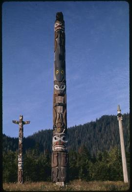 L-R, Raven pole #24, Dogfish pole #23, secretary of state pole #27, Saxman Park, Ketchikan, Alaska