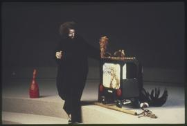 Garbanzo the Clown performs with props